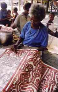 Maisin women, papua New Guinea, painting barkcloths. The red paint is applied warm and used to be associated with blood and taboo for men and children.